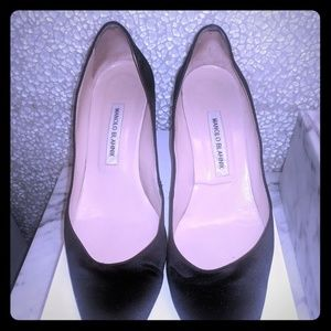Classic black satin Manolo Blahnik pumps.